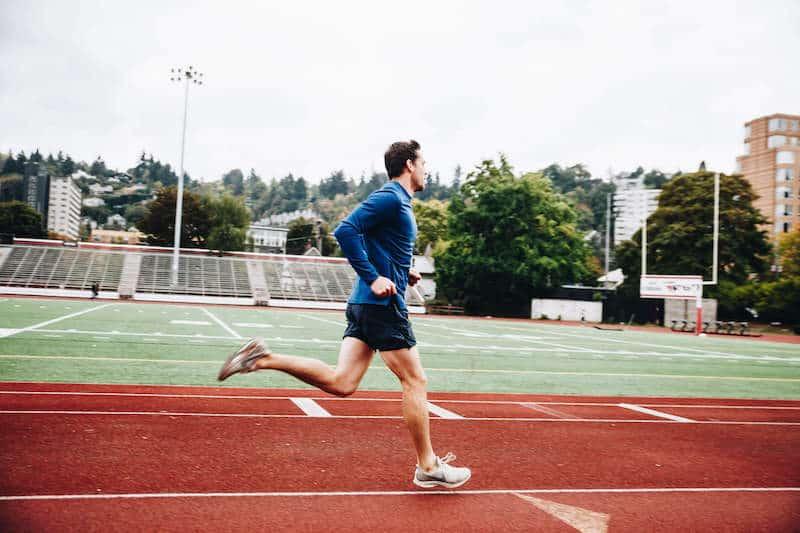 MovementX man running on track