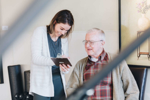 Physical therapist performing medical interview of geriatric man in Lake Oswego, Oregon